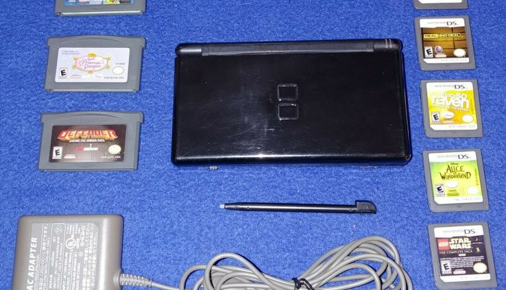 Nintendo DS Lite. Matte Unlit. Wall charger, stylus and eight video games. Refurbished.