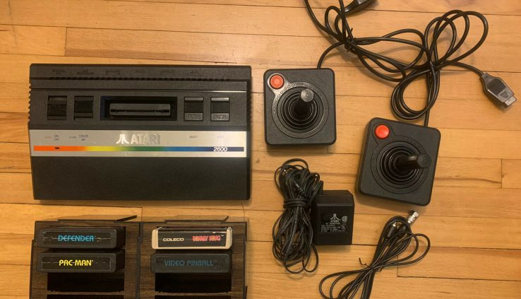 Atari 2600 Jr. Video Recreation Console. Mini Rainbow System Dim games controllers
